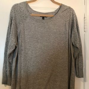 Gray sweater with shoulder and arm detail